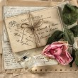 Old love letters, perfume and dried rose flower. scrapbook paper — Stock Photo #58979823