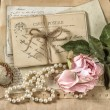 Old letters, postcards, rose flower and vintage things — Stock Photo #58979871