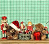 Nostalgic christmas decoration with antique toys — Stock Photo