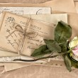 Dried rose flower and old letters. scrapbook — Stock Photo #58980045