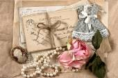 Old letters, postcards, dry rose flower and vintage things — Stock Photo