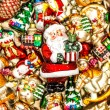 Santa Claus with christmas tree decorations, toys and colorful o — Stock Photo #59018693