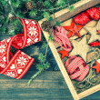 Christmas decorations wooden stars and red ribbons — Stockfoto #59018881