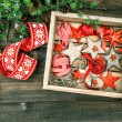 Christmas decorations wooden stars and red ribbons — Zdjęcie stockowe #59018917