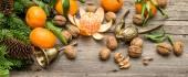 Mandarin fruits with walnuts — Stock Photo