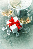 Champagne and gift box — Stock Photo