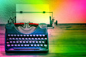 Vintage typewriter with color spot lights. Creativity concept — Stock Photo
