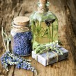 Massage oil, herbal soap and bath salt with fresh lavender flowe — Stock Photo #62874537
