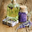 Massage oil, herbal soap and bath salt with fresh lavender flowe — Stock Photo #62874805