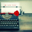 Vintage typewriter with white paper and red rose flower. Love St — Stock Photo #62876339