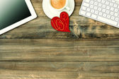 Red love heart, tablet pc, coffee. Valentines Day workplace — Stock Photo