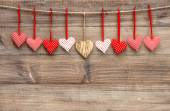 Red hearts over wooden background. Valentines Day decoration — Stockfoto