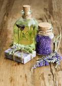 Massage oil, herbal soap and bath salt with fresh lavender flowe — Stock Photo