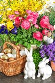 Easter home decoration with fresh spring flowers, bunny and eggs — Stock Photo