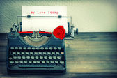 Vintage typewriter with white paper and red rose flower. Love St — Stock Photo