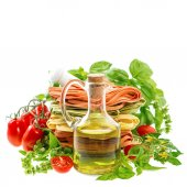 Olive oil with italian pasta, herbs and tomatoes. Food backgroun — Stock Photo