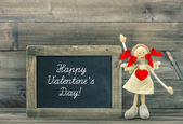 Doll with Red Heart. — Stock Photo