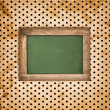 Vintage green chalkboard with wooden frame over retro style wall — Stock Photo #63946959