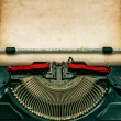 Vintage typewriter with textured grungy paper — Stock Photo #63948015