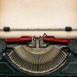 Antique typewriter with aged paper — Stock Photo #63948017