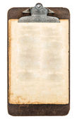 Antique clipboard with sheet of aged grungy paper — Stock Photo