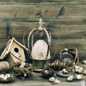 Easter home decoration with eggs, nest and birdcage — Stock Photo