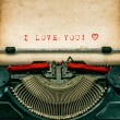 Vintage typewriter with textured grungy paper. I love You — Stock Photo #64254571