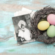 Easter eggs in nest and antique greetings card — Stock Photo #64617853