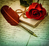 Old letters, rose flower and antique feather pen.  Vintage style — Stock Photo