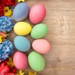 Spring flowers and colored eggs. — Stock Photo #67848723