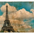 Vintage style postcard from Paris with Eiffel Tower. Grunge text — Photo #77283130
