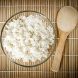 Steamed rice on bamboo background. Asian cuisine — Stock Photo #77312316
