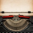 Antique typewriter with aged textured paper sheet — Stock Photo #77465354