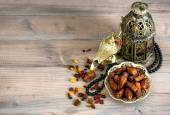 Dates, arabic lamps and rosary. Islamic holidays decoration — Stock Photo