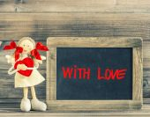 Sweet girl with Red Heart. Holidays decoration. Blackboard — Stock Photo