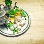 Mint tea with arabic delight. Oriental hospitality. Vintage styl — Stock Photo #79071602