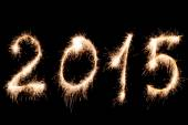 Happy New Year 2015- inscription made sparklers. — Stock Photo