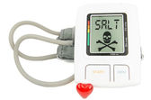 Salt and Digital blood pressure monitor — Stock Photo