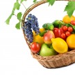 Fruits and vegetables in a wicker basket isolated on white backg — Stock Photo #53802055