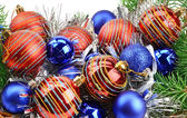 Christmas decorations and spruce twigs — Stock Photo