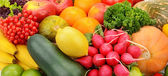 Bright background of fruits and vegetables — Stock Photo