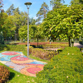 Beautiful summer park with street lamp — Stock Photo