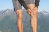 Runner with knee pain — Stock Photo