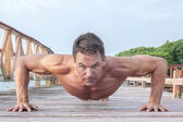 Outdoor push up workout — Stock Photo