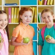 Three charming girls with green apples — Stock Photo #53801873