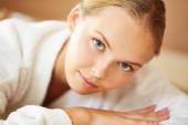 Young female in white bathrobe — Stock Photo