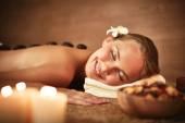 Young female enjoying spa procedure — Stock Photo