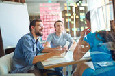 Young business partners sharing ideas — Stock Photo