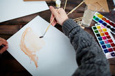 Man drawing with water-colors — Stock Photo