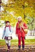 Two schoolgirls going home — Stock Photo